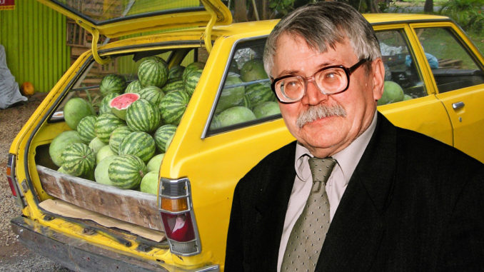 Math professor standing in front of car loaded with watermelons